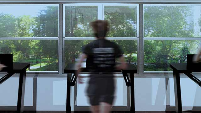A woman running on a treadmill