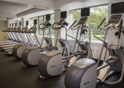Ellipticals and treadmills in fitness center at Rittenhouse Claridge apartments
