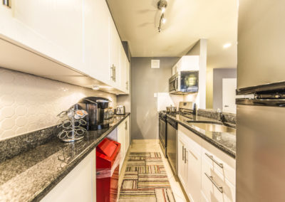 Spacious kitchen with stainless steel appliances and granite countertops in Rittenhouse Square apartments