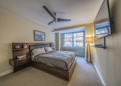 Furnished master bedroom in Rittenhouse Claridge apartment