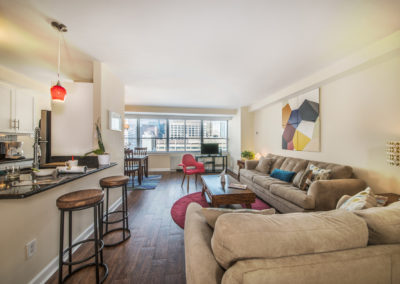 Furnished living room in open floor plan with Walnut Street views in Philadelphia, PA apartment