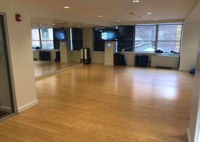Fitness studio with mirrored walls and yoga mats for Rittenhouse Claridge residents to use in Philadelphia, PA