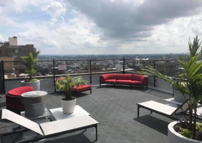 Spectacular Rittenhouse Claridge rooftop with comfortable lounging chairs and beautiful city view in Philadelphia, PA