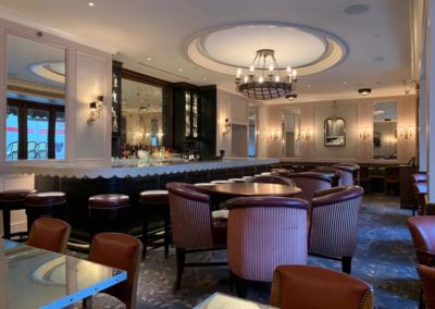 Phenomenal lounge room with extravagant bar, comfortable seating options and dangling chandelier at Rittenhouse Claridge